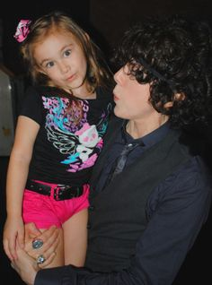 LP teaching a young fan how to whistle