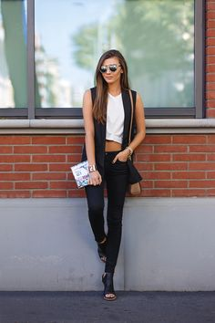 justthedesign:  Larisa Costeapairs her black sleeveless jacket with a cute white crop top and black denim jeans.Sleevless Jacket: Shein, Top:Oasap, Jeans:DSTLD.
