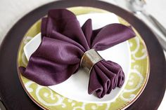 Add a little flair to your table settings with decorative napkins and stylish folds.