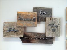 Reclaimed wood art with vintage auto emblems.