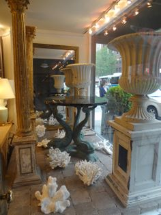 NYC #nautical window display with #coral decor and #pedestal #planters are perfect for this season! #interiordesign #NewYork #MecoxGardens #furniture #shopping #home #design #room #designidea #vintage #antiques #garden