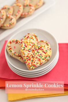 lemon cookies with sprinkles mixed in cut into heart shapes, iced with lemon icing and more sprinkles.