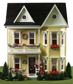A splendidly pretty Princess Anne dollhouse decked out for the holidays. #dollhouse #toys #Christmas