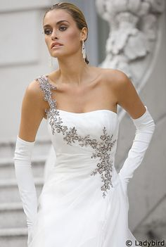 One shoulder gown with silver trim and long gloves. Gorgeous!