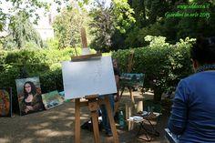 Esposizione dei dipinti nel giardino Aymerich.  Exhibition of paintings in the garden Aymerich.