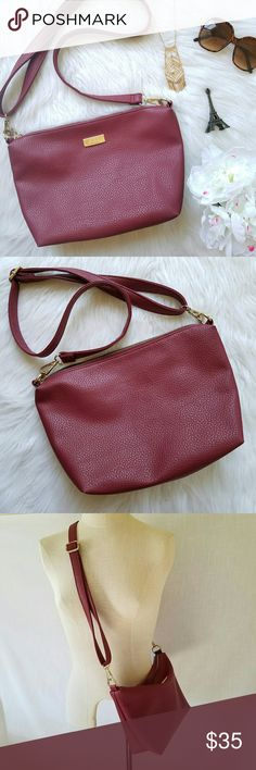 """BCBG Paris Slouchy Boho Crossbody Purse Wine Red BCBG Paris from BCBGMaxAzria Collection. Pebbled faux-leather exterior in Wine Red. Gold tone hardware.  Zip top closure. Black interior lining.  1 inside zip pocket. 2 slip pockets. 9"""" x 13"""" x 4""""  Adjustable crossbody / shoulder strap. EXCELLENT condition! BCBGMaxAzria Bags Crossbody Bags"""