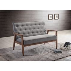 A simple, post-modern design that works well with a variety of styles, the Sorrento 2-seater loveseat is upholstered in grey polyester fabric with solid rubberwood legs and frame.