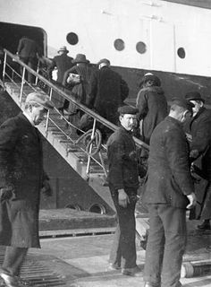 Travelers board the RMS Titanic. Photo: Father Frank Browne