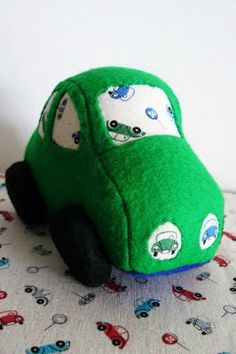 stuffed toy car, nice and soft to play with in a real vehicle, or to take to bed!
