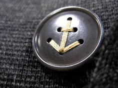 This button is fabulous! It's from a men's jacket, but I would love to see it used on cushion or other soft furnishings in my coastal inspired interior!