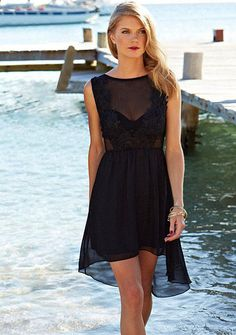 Woven hi-lo dress. Crochet detail on chest. Skirt lined. Sheer top. Add layering piece.