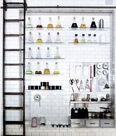 That's how the Remodelista editors like their holidays. Above: Lab flasks, a rolling ladder, and a steel pegboard are among the industrial-style kitchen elements Alexa deconstructs in this w Home Interior, Kitchen Interior, Interior And Exterior, Design Kitchen, Simple Interior, Kitchen Tiles, Restaurant Design, Küchen Design, House Design