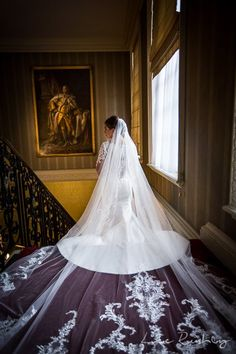 Bridal portrait taken by Hedsor House Photographer, Lee Rushby. Wedding dress with cathedral veil.