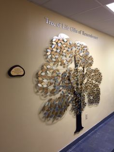 Beautiful donor tree with multicolored leaves representing various giving levels.