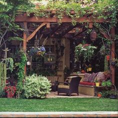 lovely patio and pergola covered in vines.  l
