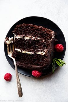 Dramatic and delicious tuxedo cake featuring moist chocolate cake, white chocolate ganache filling, and dark chocolate silk frosting. Not for the faint of heart! Cake recipe on sallysbakingaddiction.com