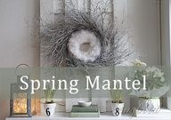 Spring mantel display with a twig and feather wreath combo and of course with fresh greens and flowers.