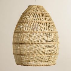 Hand-woven of renewable bamboo with an eye-catching texture, our exclusive natural fiber lamp has an open design that shines warm ambient light into the room.