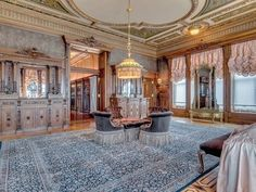 The elegant reception rooms feature hand-carved woodwork and plaster ceilings. There are original chandeliers and fixtures believed to be from Tiffany Studios, walnut and oak flooring with ebony inlays, five hand-carved marble fireplaces, original tapestries, and plaster ceilings.