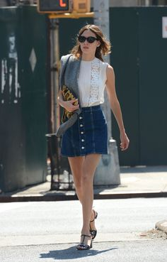 Button-up denim mini, romantic blouse, and low heels.