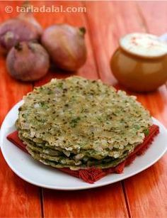 The onion roti is flavorful yet moderately-spiced so it will be appealing to the whole family. Spiced with cumin seeds, ginger, coriander and green chillies, this whole wheat based roti is rather versatile-it can be had with an elaborate vegetable preparation or just a cup of curds and pickle.