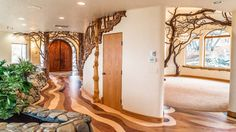 This Oregon home is filled with copper tree sculptures throughout and intricate woodwork looks like it is from The Lord of the Rings