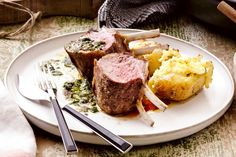 Create a Greek inspired meal with this roasted lamb rack served with Greek Chimichurri sauce and haloumi potatoes. Created by Curtis Stone.