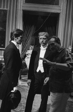 Alain Delon and Burt Lancaster take direction from Luchino Visconti on the set of 'Il Gattopardo' (1963)