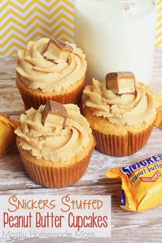 Snickers Stuffed Peanut Butter Cupcakes - These yummy cupcakes start with a cake mix, are filled with SNICKERS peanut butter squares and topped with creamy sweet peanut butter frosting!