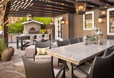Flat Stone Patio Design, pergola covered patio, wall and hanging lanterns. I would add a splash of color and more patio plants. Rustic Outdoor, Outdoor Seating, Outdoor Rooms, Outdoor Dining, Outdoor Furniture Sets, Outdoor Decor, Rustic Furniture, Antique Furniture, Outdoor Pergola
