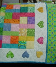 Beautiful bright colors for a baby, love the heart border.
