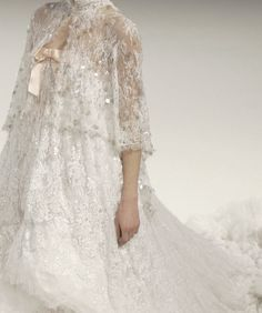 This would make the most perfect wedding dress, very modest and lovely detail.
