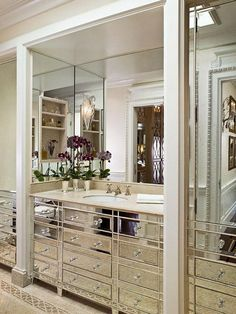 bathroom walls surrounding sinks where medicine cabinets belong use all mirror