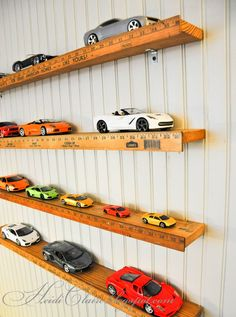 Yardstick shelves on Heidi Claire blog. A great way to display model cars in boy's room.