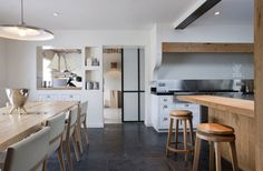 gorgeous pine dining table.  wood, metal stone in kitchen. olivier-chabaud-maison-villennes-13