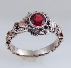 Garnet Industry Ring by FernandoJewelry on Etsy, $365.00   (If it had a purple stone.... <3)