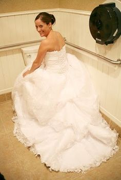 How to use the toilet in your wedding dress! haha! God bless pinterest.  Im thinking ill have a bride only stall , lol