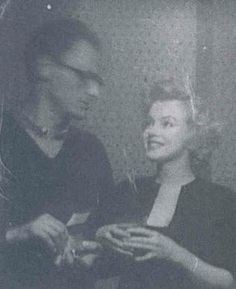 Marilyn and Arthur Miller at a party, 1956.