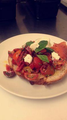 Bruschetta made with heirloom tomatoes fine onions basil mint sweet balsamic glaze on olive oil charred sourdough