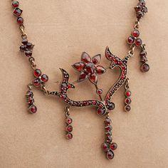 Garnet necklace, bohemian garnet in tombak, about 1900.