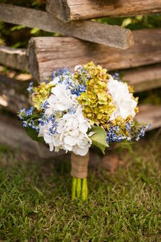 blue and green wedding bouquet http://www.weddingchicks.com/2013/10/25/blue-and-green-country-wedding/