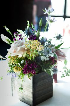 berry toned arrangement // photo by Levi Stolove // view more: http://ruffledblog.com/industrial-literature-wedding-in-nyc/