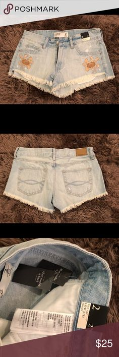 Brand new never worn A&F low rise short - size 2 NWT never worn Abercrombie & Fitch low rise short in size 2 / w 26. Tag is still on. Too tight for me and am cleaning out my closet. Pet free and smoke free home. Priced to sell. Embroideries on both side of the pockets. Happy poshing! Abercrombie & Fitch Shorts Jean Shorts