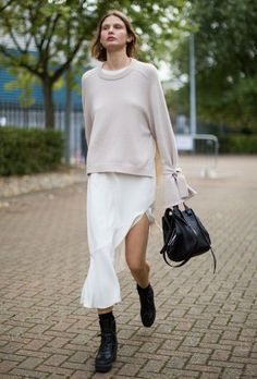 1 Cream sweater w interesting details. 2Silk midi skirt and 3black booties.