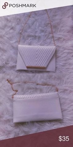 White and Gold clutch💥24 HR SALE💥 Brand new never been used white and gold clutch. Bags Clutches & Wristlets