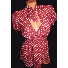 F21 Sheer Polka Dot Blouse Sz S Romantic and feminine sheer red layering blouse with white polka dots. Low cut wrap styled bust with tie accent at neck. Fitted elastic smocked waist with babydoll flow.  By Forever 21. No size label but fits a Small. Good pre-owned condition with no holes, rips or stains. Forever 21 Tops Blouses
