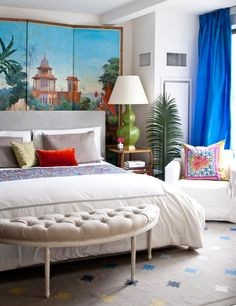 A hand-painted screen from John Roselli Antiques behind a headboard sets the stage for the bedroom's colorful accents. - Traditional Home ® / Photo: John Bessler / Design: Nick Olsen