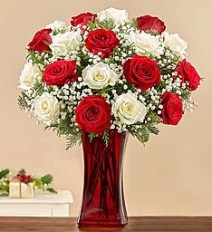 "Merry & Bright™ Rose Bouquet It's merry. It's bright. It's a cheerful bouquet guaranteed to make anyone's holiday! Fresh red and white roses are hand-gathered with gypsophila (""baby's breath"") and mixed Christmas greens in a sleek and festive ruby red vase. Surprise a friend or loved one who looks forward to putting the traditional Christmas colors on display each year... or send one to yours-elf!"