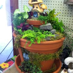 Gnome hiding in fairy garden with water feature above by Kristin Middleton #colonialgardenskc