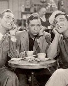 Gene Kelly, Oscar Levant and ?    Scene from An American in Paris